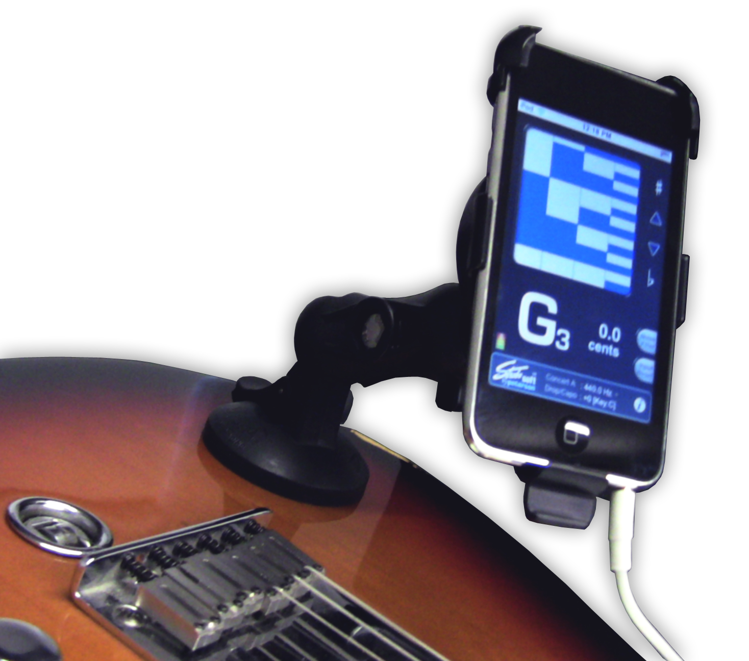 This holder for iPods and iPhones attaches to your guitar so you can display lyrics, chords, and more on your iPod or iPhone's screen. | Peterson Strobe Tuners